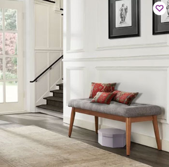white walls and paneling with modern bench