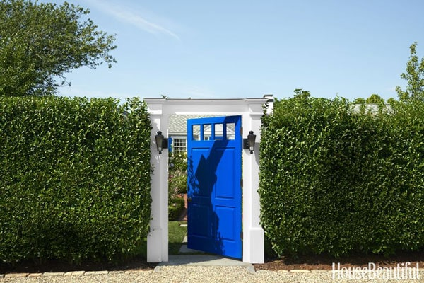 BM New York State of Mind blue door in hedge