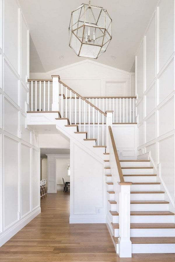 gorgeous white paneling in formal foyer- the best white trim paint colors including BM Simply White