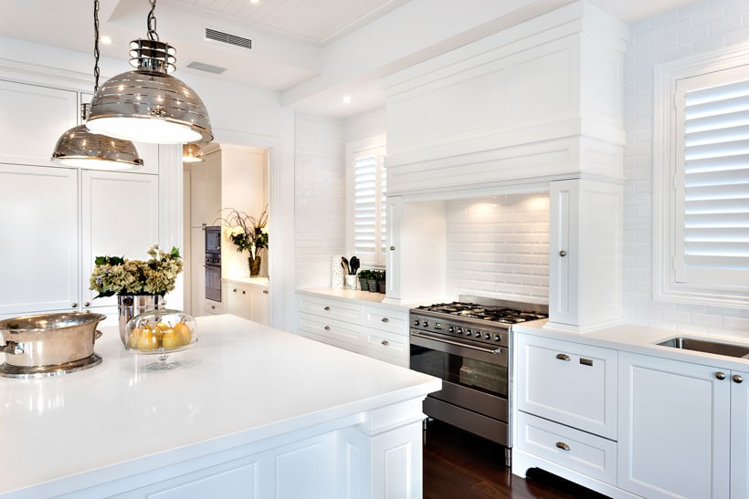 best cabinet colors for kitchen islands and walls-- crisp white kitchen with marble countertops