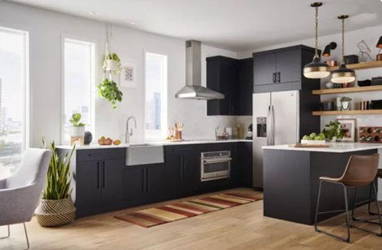 black modern kitchen with red rug