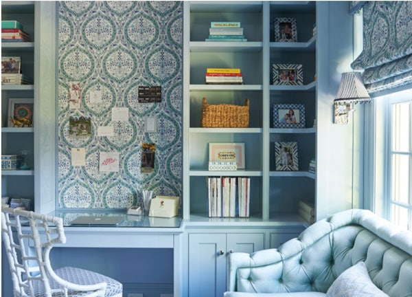 beautiful light blue built-in shelves with blue wallpaper in home office
