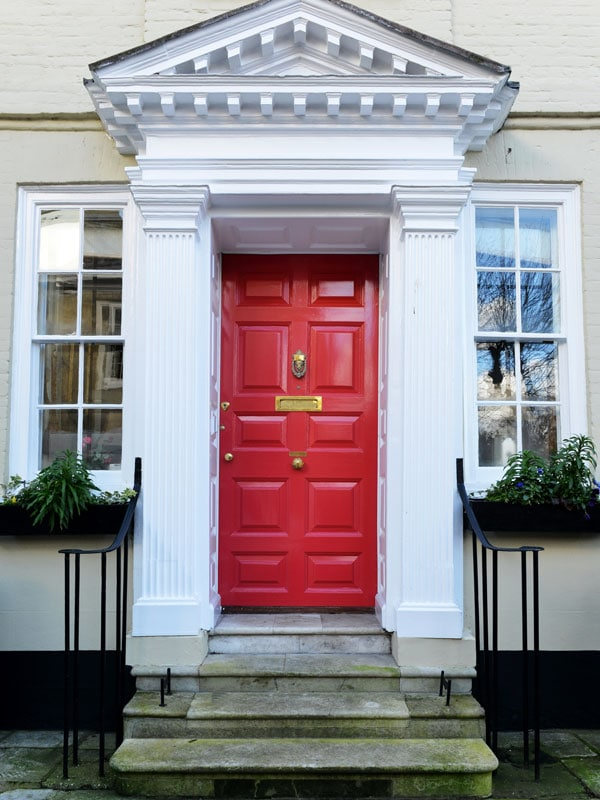 bright red front door with white columns