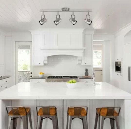 bright white kitchen cabinets and walls in kitchen