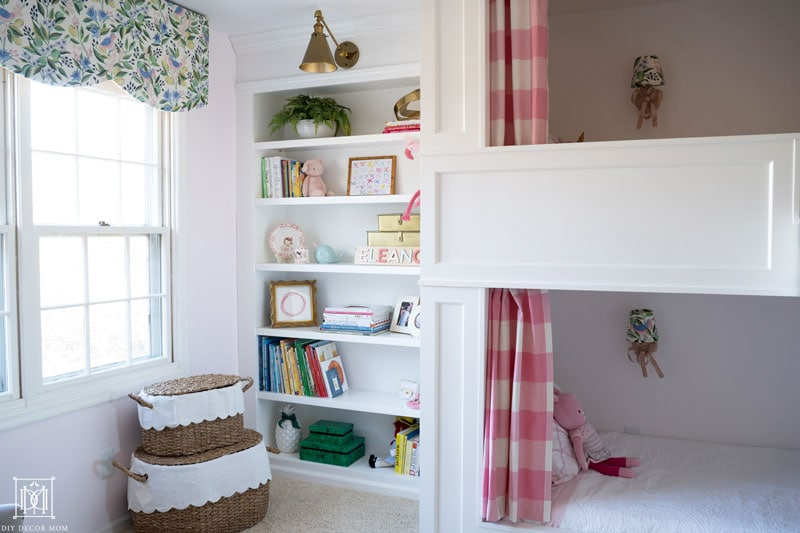 scalloped diy valance and window cornice box in shared girls bunk room with built-in bunk beds and built-in bookshelves