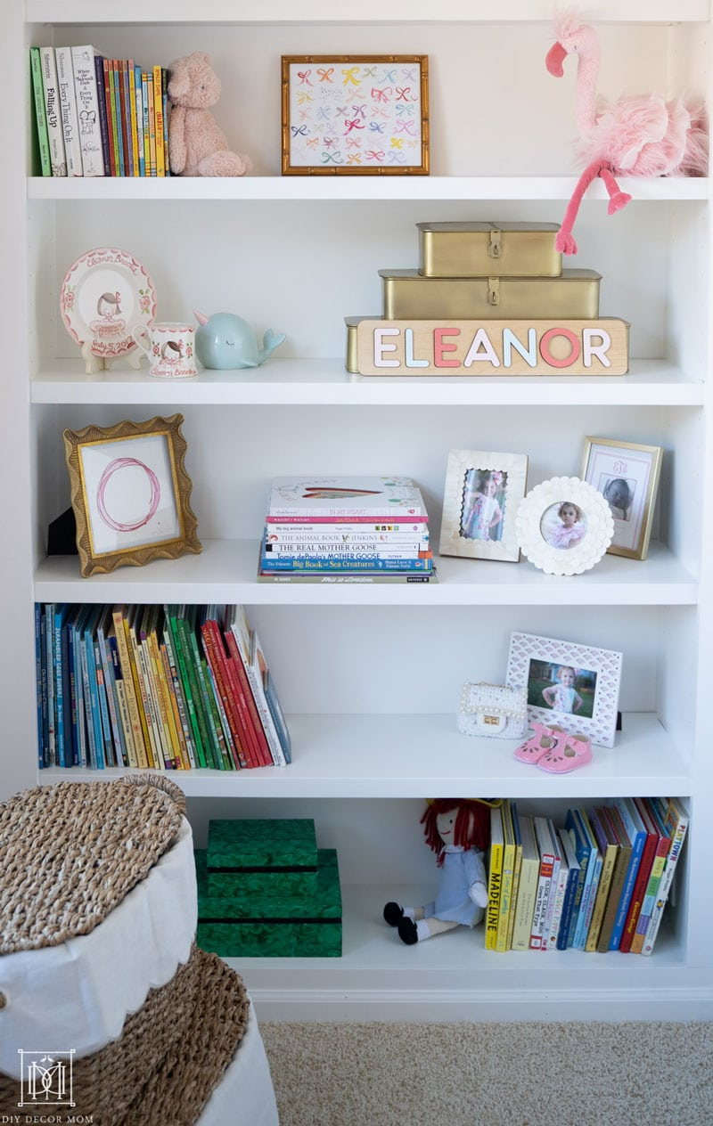 girls bookcases with detailed shots of decorative accessories and picture frames