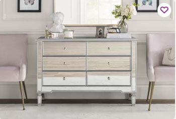 gorgeous glam mirror dresser in white room with beautiful white trim paneling and baseboard