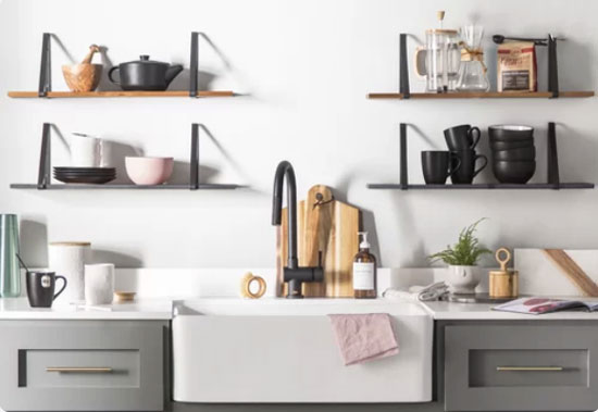 gray shaker kitchen cabinets with brass hardware