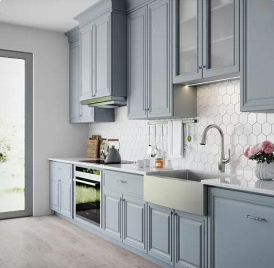 grayish blue kitchen cabinets with hex tile backsplash in kitchen