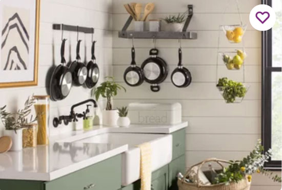 sage green colored kitchen cabinets in farmhouse style kitchen