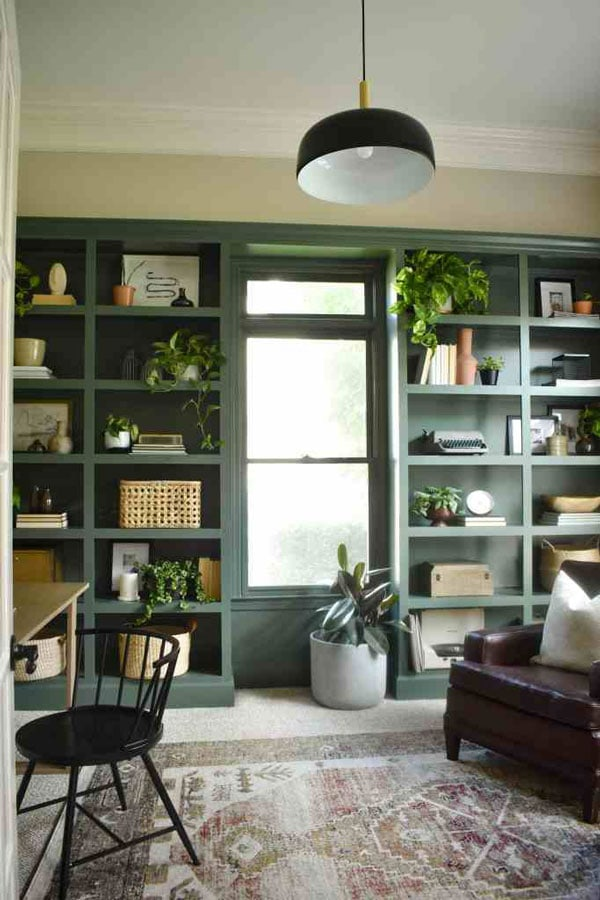 green painted bookshelves in home office