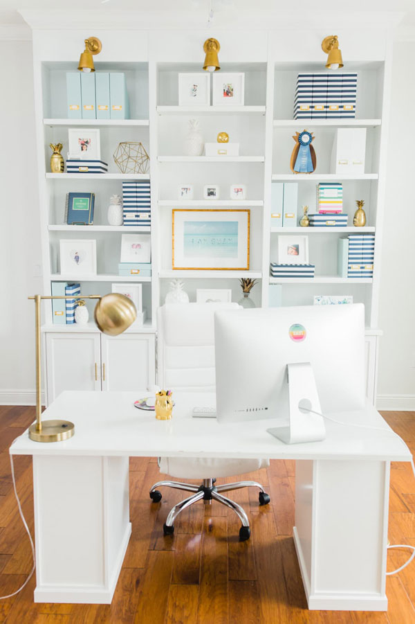 white at home office with white bookshelves- emily ley