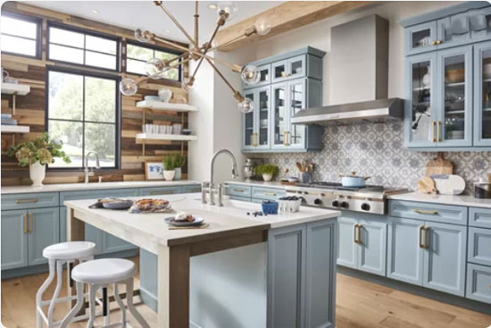 light blue kitchen cabinets with wood accent wall