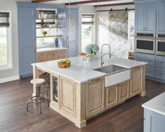light blue painted kitchen cabinets with natural wood tone island
