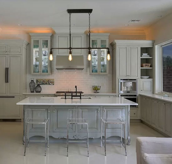 light gray greenish cabinets with lucite countertop stools