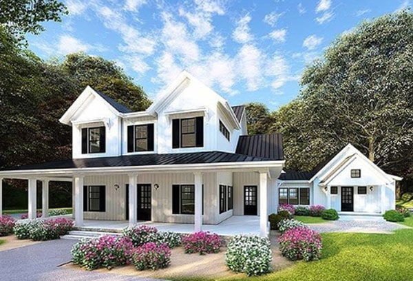 modern white farmhouse with black front door