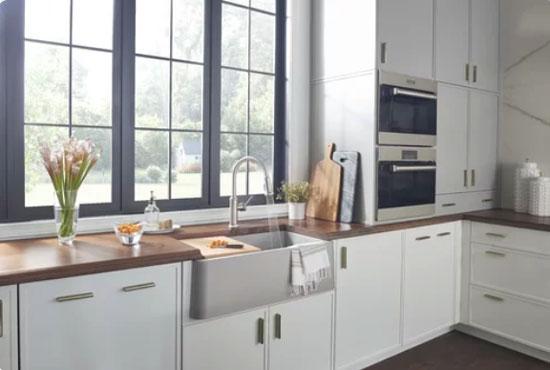 modern white kitchen cabinets with marble backsplash