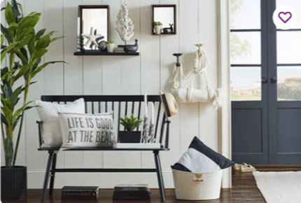 white shiplap and trim walls with black farmhouse bench