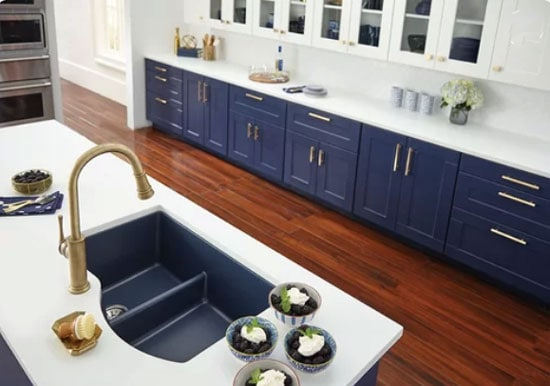 navy blue kitchen cabinets and reddish floor