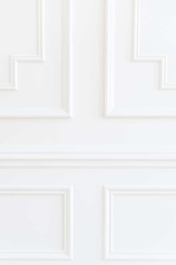 detail of white trim millwork in rachel parcell's house featuring BM Dove Wing--one of the best white trim colors