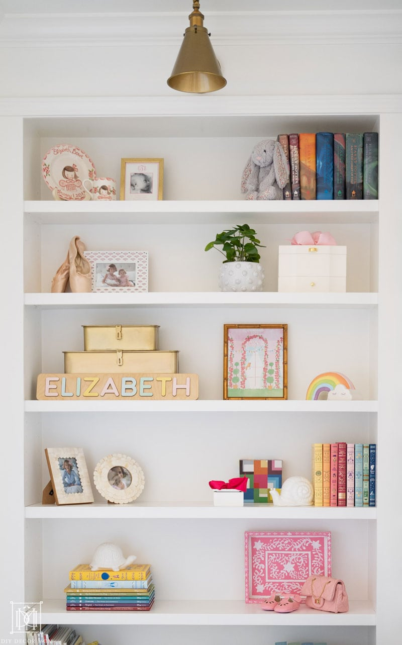 styled girls bedroom bookshelf in built-in bookcase