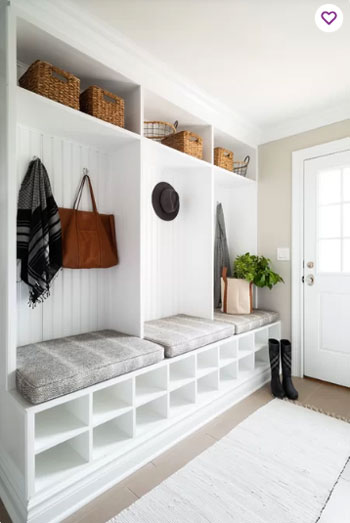 coastal white built-in cabinets in mudroom