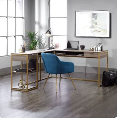 gray walls in home work space with modern desk and blue upholstered desk chair