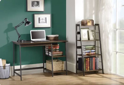 green accent wall with desk and bookcase