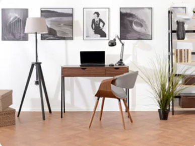 white walls in home workspace with modern wood desk and lamp