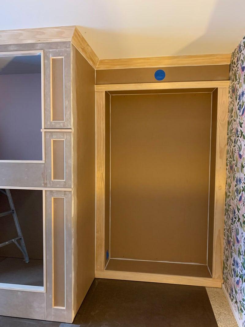 caulk the seams of the trim for a diy bookcase
