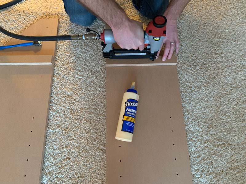 glue and brad-nail sides of bookcase into place