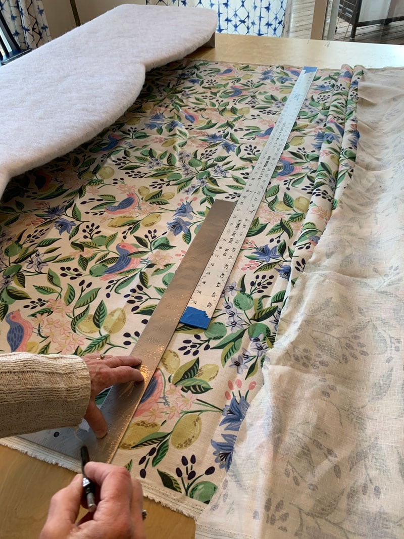 seaming together fabric to cover a window cornice