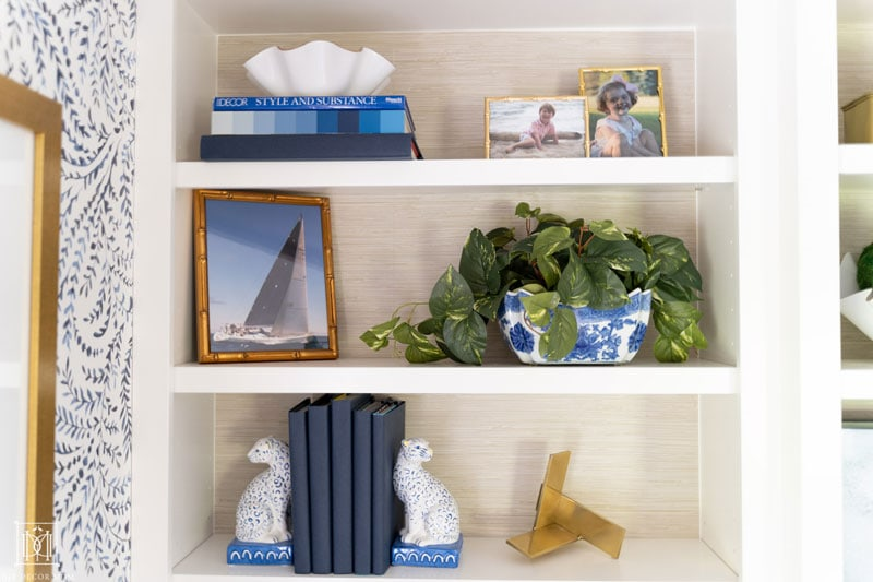 how to style built-in bookshelves with faux grasscloth