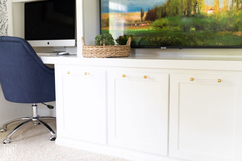 lucite pulls on built-in cabinets in office