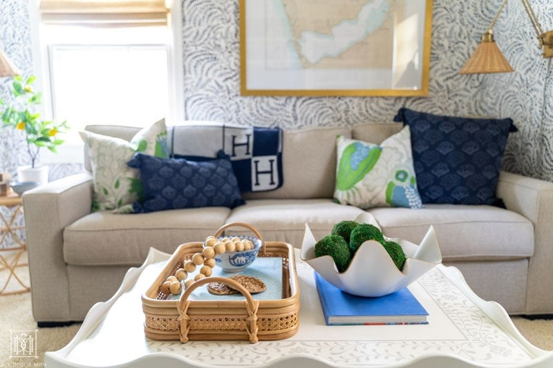 scalloped coffee table styled with bamboo and cane tray and wavy bowl