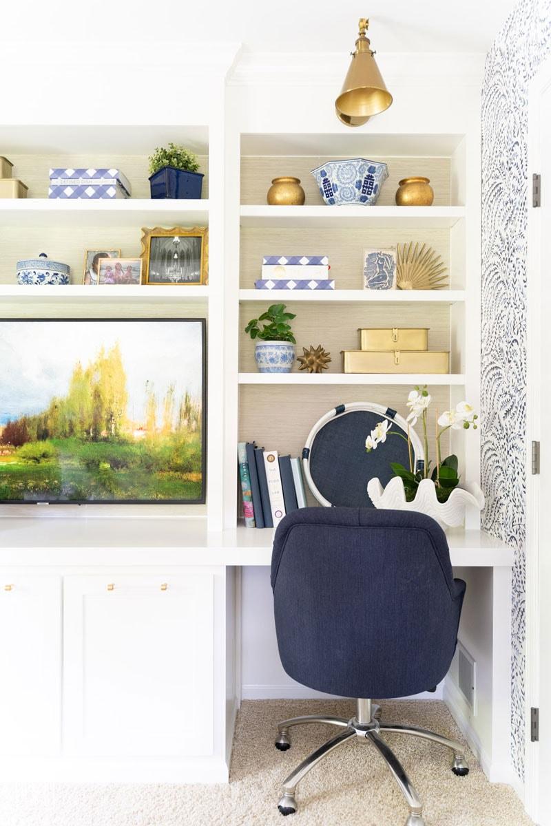 grasscloth wallpapered bookshelves with diy built-in bookshelves