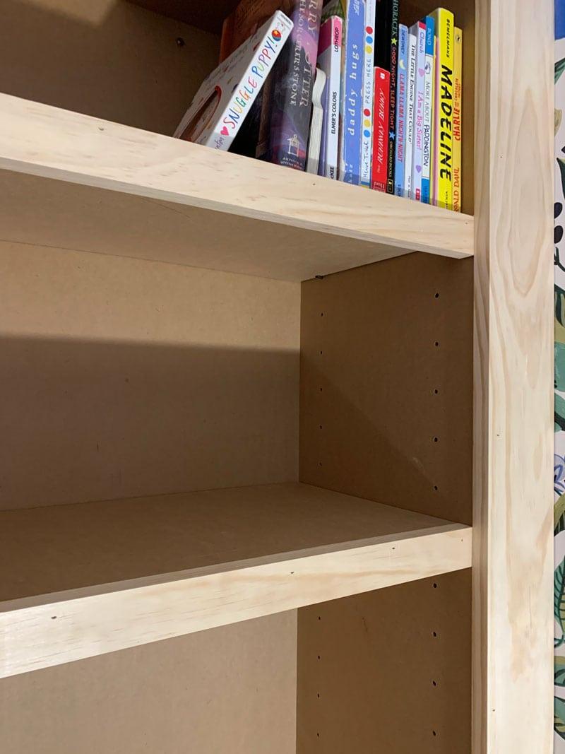 shelves and trim on diy built-in bookshelf