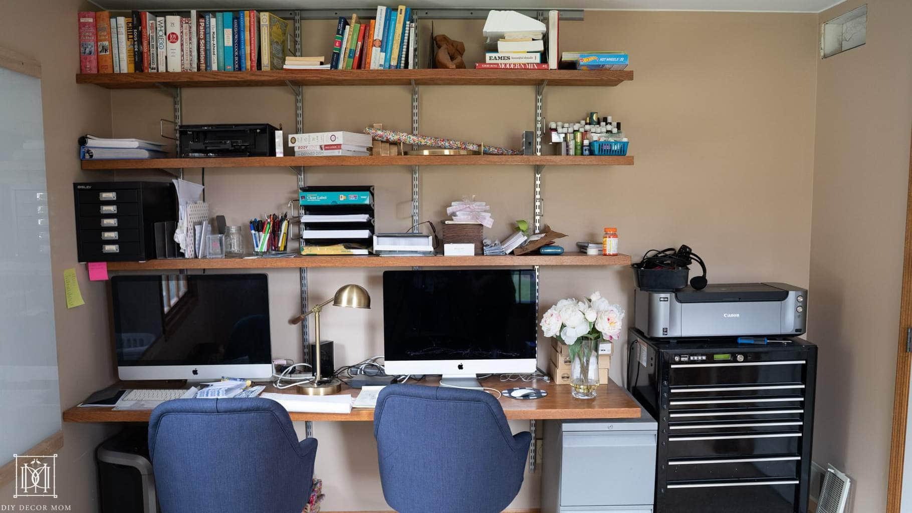 ugly before photo of home office with built-in shelves and two desks