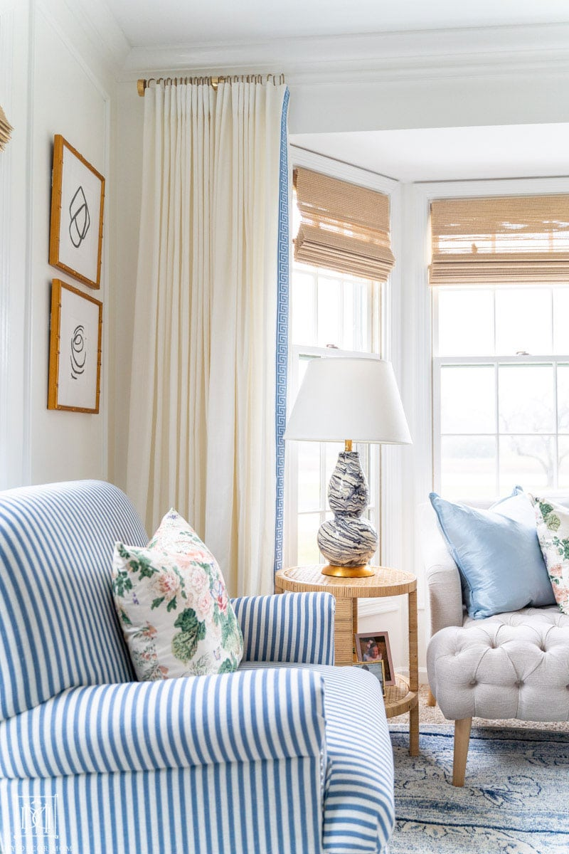 white living room walls with white curtains and bamboo shades