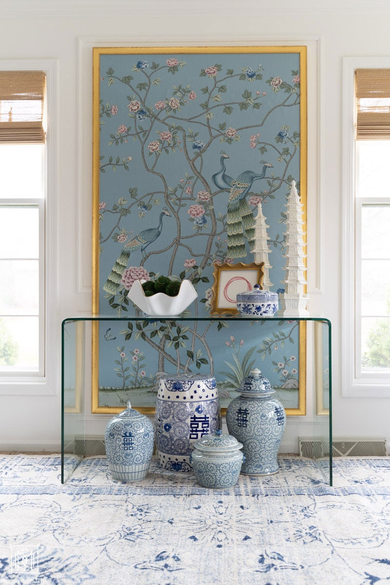 diy framed chinoiserie panel and blue and white ginger jars with lucite table