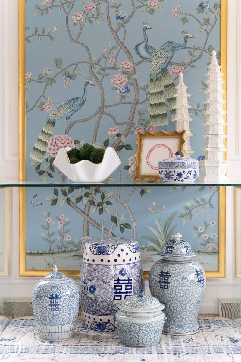 beautiful handpainted chinoiserie panels with blue and white ginger jars and pottery