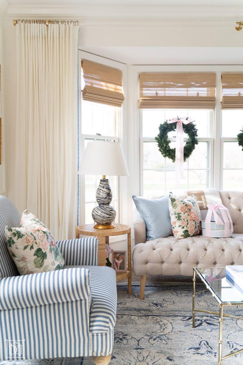 custom acrylic curtain rod in living room with bay window and sofa