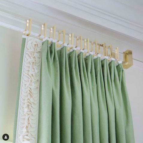 beautiful custom acrylic curtain rod with green curtains by jenkins interiors