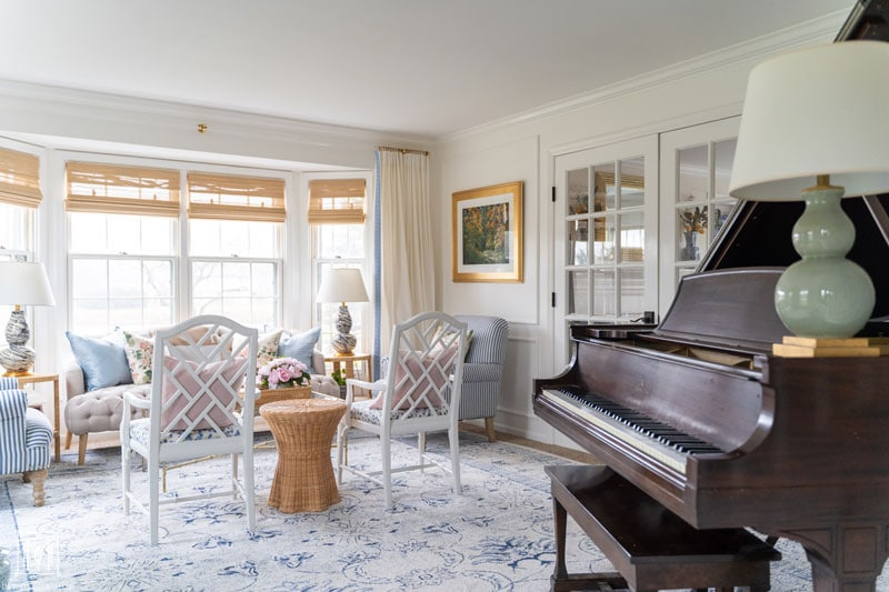 bay window with acrylic curtain rod in living room with blue oriental rug