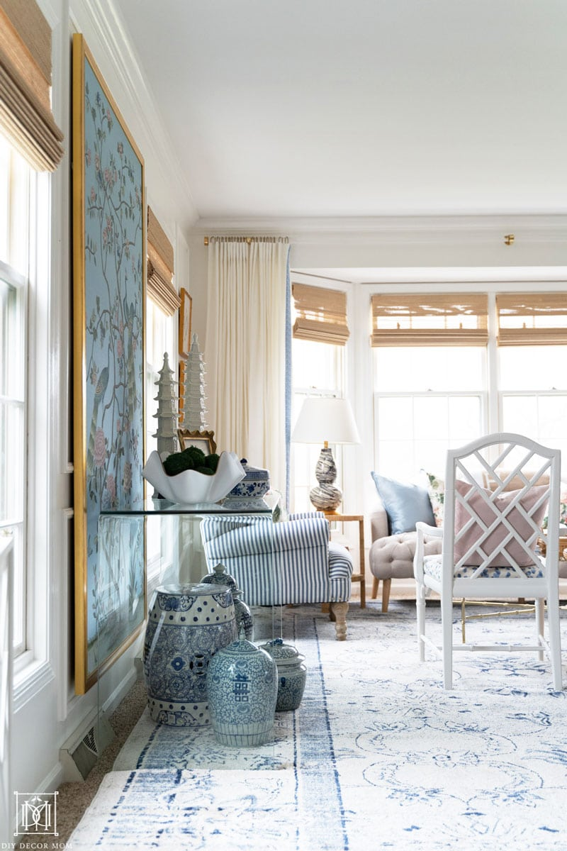 beautiful blue and white living room with custom diy lucite curtain rod and white curtains